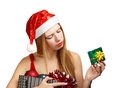 Young woman in santa hat with christmas attributes and little gi beautiful claus suit holding box new year gift box isolated on Stock Photo