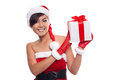Young woman with Santa hat holding Christmas gift against white Royalty Free Stock Photo