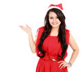 Young woman with santa hat showing blank space Stock Images