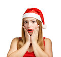 Young woman in santa hat surprised beautiful claus isolated on white background Stock Images