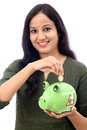 Young woman saves money in piggy bank indian against white Royalty Free Stock Photography