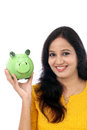 Young woman saves money in piggy bank indian against white Royalty Free Stock Photo