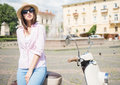 Young woman on scooter beautiful in nifty hat standing near outdoors Stock Photography