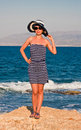 Young woman at sea shore crete greece Stock Images
