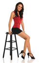 Young Woman Seated on Stool Royalty Free Stock Image