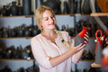Young woman selecting ceramics with red enamel in atelier Royalty Free Stock Photo