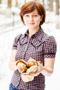 Young woman selling baguettes joy Stock Photography