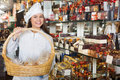 Young woman selling gifts of fine chocolates Royalty Free Stock Photo
