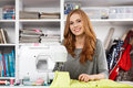 Young woman at a sewing machine Royalty Free Stock Photo