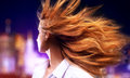 Young woman shaking hair on night city background Royalty Free Stock Photos