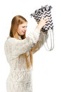 Young woman shaking out her bag in search Royalty Free Stock Photo