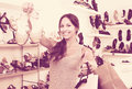 Young woman in shoes store Royalty Free Stock Photo