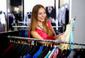 Young woman in a shop buying clothes Stock Photo