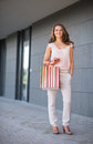 Young woman with shopping bag on the mall alley full length portrait of Stock Photo