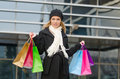 Young woman with shopping bags in black in vilnius lithuania Royalty Free Stock Image