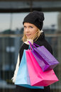 Young woman with shopping bags in black in vilnius lithuania Stock Image