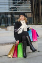 Young woman with shopping bags in black in vilnius lithuania Stock Photos