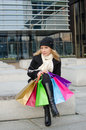 Young woman with shopping bags in black in vilnius lithuania Royalty Free Stock Photo