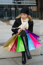 Young woman with shopping bags in black in vilnius lithuania Stock Photography