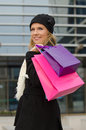 Young woman with shopping bags in black in vilnius lithuania Stock Images