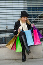 Young woman with shopping bags in black in vilnius lithuania Royalty Free Stock Photos