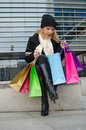 Young woman with shopping bags in black in vilnius lithuania Stock Photo