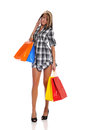 Young woman with shopping bags and cell phone Royalty Free Stock Images