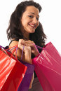 Young woman with shopping bags close-up isolated Royalty Free Stock Photography