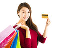 young woman with shopping bags and credit card Royalty Free Stock Photo