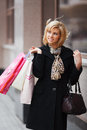 Young woman with shopping bags happy Stock Image