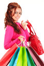 Young woman with shopping bags isolated on white background Royalty Free Stock Photos