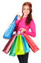 Young woman with shopping bags isolated on white background Royalty Free Stock Photo