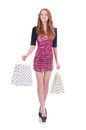 Young woman with shopping bags on white Royalty Free Stock Image