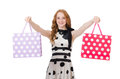 Young woman with shopping bags on white Stock Images