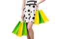 Young woman with shopping bags on white Royalty Free Stock Photography