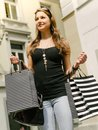 Young woman shopping in the city photo of a beautiful walking through holding bags Stock Photos