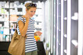 Young woman shopping for the right fragrance Royalty Free Stock Photo