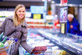 Young woman shopping in a supermarket Stock Photos