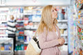 Young woman shopping at supermarket caucasian women with handbag Stock Photography