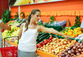 Young woman shopping in a supermarket in the department of fruit