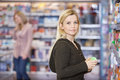 Young woman shopping at supermarket portrait of caucasian women Stock Photo
