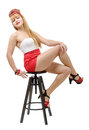 Young woman with shorts, sitting on a stool Royalty Free Stock Photo