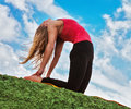 Young woman show camel yoga pose outdoor practice Royalty Free Stock Images