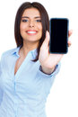 Young woman showing display of mobile cell phone with black screen and smiling on a white background focus on hand Royalty Free Stock Photography