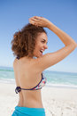 Young woman showing her happiness in front of the sea Royalty Free Stock Photography