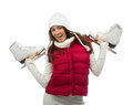 Young woman showing ice skates for winter ice skating sport activity in white hat smiling isolated on a white background Royalty Free Stock Photography