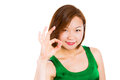Young woman showing ok hand sign smiling happy perfect pretty asian isolated on white background Royalty Free Stock Photo