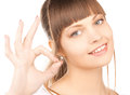 Young woman showing ok sign Stock Photo