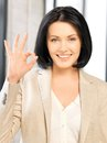 Young woman showing ok sign bright picture of Stock Image
