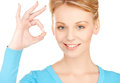 Young woman showing ok sign bright picture of Stock Photography